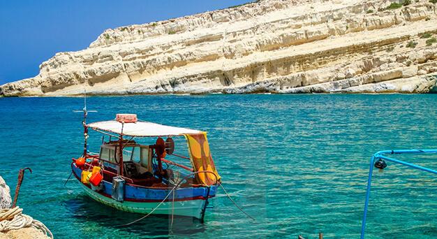 Matala beach and caves in Crete Keramoti rent a car in Kissamos